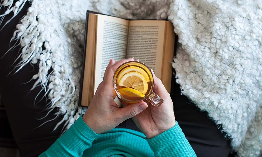 Woman Drinking Tea while reading